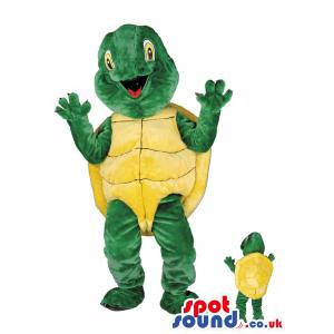Turtle mascot in a green pant and in yellow top in a surprise -