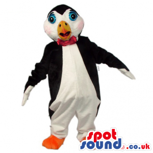 Black and white penguin with red bow tie, orange beak and feet