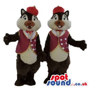 Twin brown and beige squirrels wearing a red hat and a checked