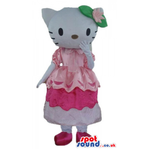Hello kitty with green and pink flower on the head wearing a