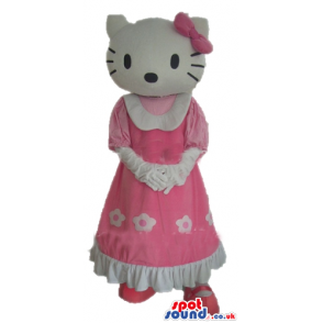 Hellow kitty with a pink bow on the head wearing a long pink