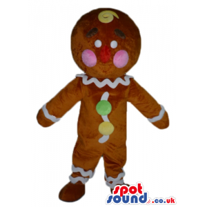 Gingerbread cookie with pink cheeks decorated in white, yellow