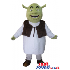 Green ogre wearing a white tunic and a brown furry vest -
