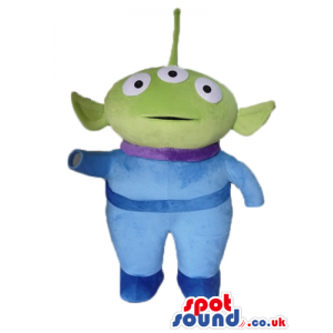 Green martian with three round eyes wearing a lightblue suit