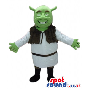 Green ogre wearing a white tunic and a brown furry vest and