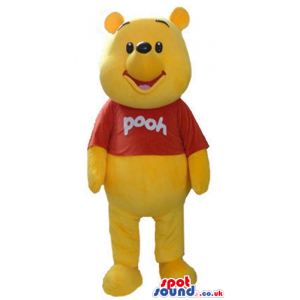 Winnie the pooh wearing a red t-shirt with an inscription -
