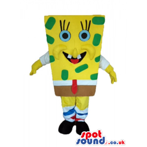 Sponge bob with green dots wearing brown shorts, and a red tie