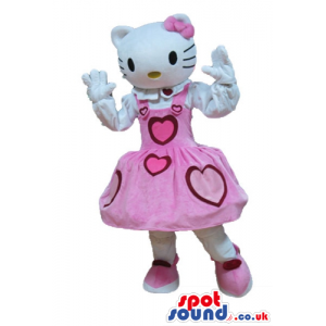 Hello kitty dressed in a long sleeveless pink dress with red