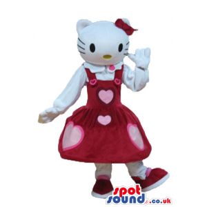 Hello kitty dressed in a long sleeveless red dress with pink