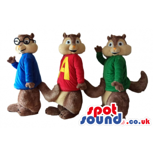 Three brown squirrels wearing a red sweater, a green sweater