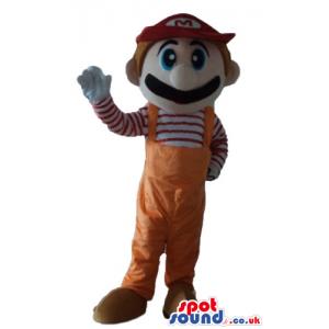 Super mario bros wearing orange gardener trousers, a striped