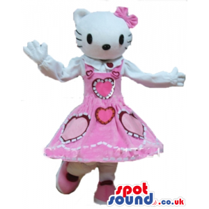 Hello kitty wearing a long sleeveless red dress with pink