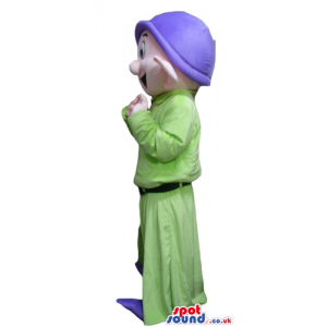 Young dwarf wearing a purple hat, a green shirt, green trousers