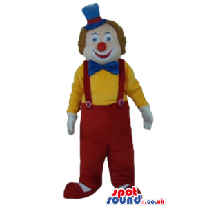 Clown with curly ginger hair and a big red nose wearing a