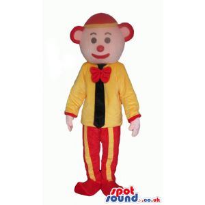 Clown with a red nose wearing a red and yellow cap, red and