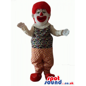 Clown with big eyes, a big red nose and curly red hair wearing