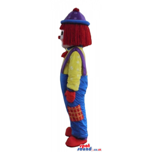 Clown with a big red nose wearing blue and green trousers, a