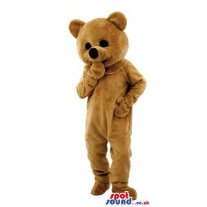Brown teddy bear mascot thinking putting his hand in his mouth