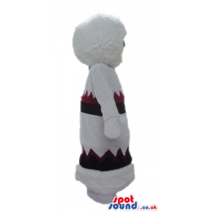 Skimo woman dressed in a warm white dress with red and black
