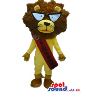 Yellow lion with a furry brown head, big round eyes, beige feet