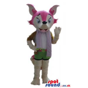 Grey fox with a pink face wearing green shorts and a purple