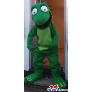 Little frog mascot in green with a happy face and waving hand -
