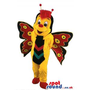 Butterfly mascot with yellow cloth and in multi colour wings -