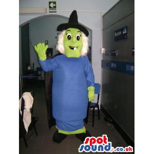 Witch woman mascot with blue dress and a black pointed hat -