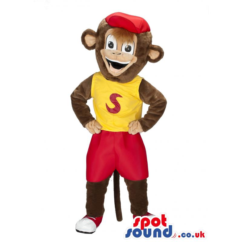Monkey mascot with red shorts and red cap and in a yellow