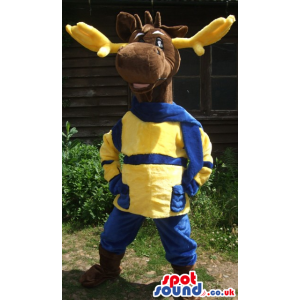Brown Reindeer Animal Mascot Wearing Blue And Yellow Clothes -