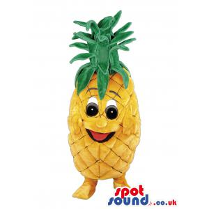 Pineapple mascot with green hair and yellow body and socks -