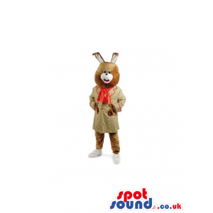 Brown Rabbit Mascot Wearing A Gown And An Orange Bow - Custom