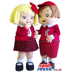 Boy And Girl Mascot Wearing Red And White School Uniform -