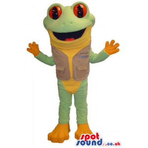 Green And Orange Frog Mascot Wearing A Vest With Red Eyes -