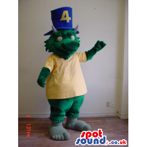 Green Dragon Mascot Wearing A Yellow T-Shirt And A Blue Top Hat