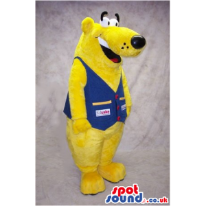 Funny Yellow Bear Mascot Wearing A Blue Vest With Logos -