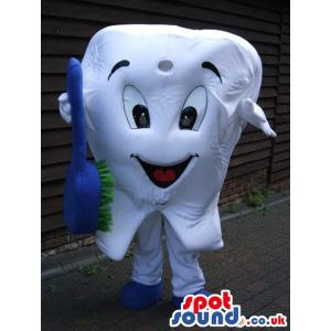 Happy teeth mascot with brush in his hands and in white -