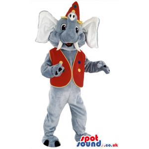 Elephant mascot with a tusk standing & smiling with red coat -