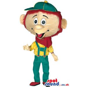 Big head boy with green cap and in green jumper and yellow