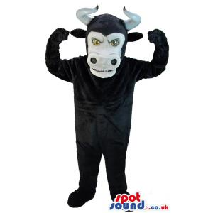Black bull mascot with horn and raising hands with amazed look