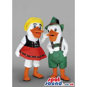 Couple white male duck with a green jumper & woman with red
