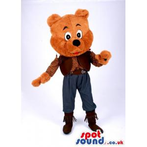 Happy brown colour teddy bear mascot with waving hand to greet