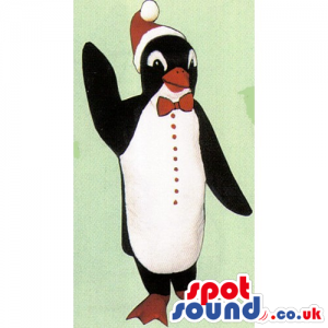 Cute Penguin Mascot Wearing A Christmas Hat And A Bow Tie -