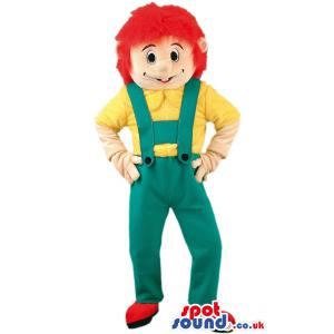 Boy mascot with red hair,green jumper and in yellow shirt -