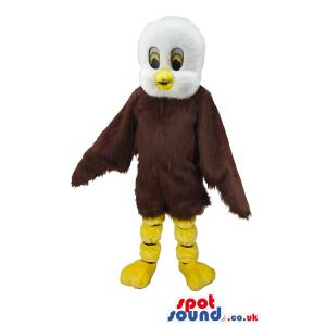 Brown bird mascot with sharp look and pointed beak in yellow -