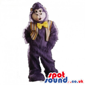 Hairy Purple Monkey Mascot Wearing A Vest And A Bow Tie -