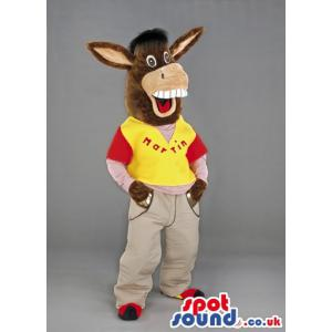 Donkey mascot in red-yellow t-shirt and in violet colour