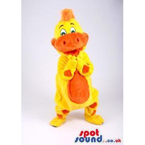 Yellow and orange crocodile mascot dancing with a nice smile -