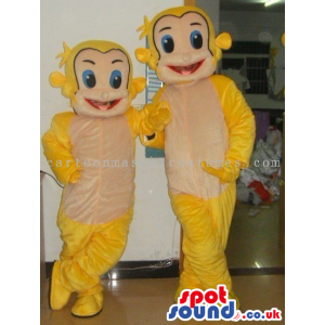 Two Small And Big Yellow Plush Monkey Mascots With A Beige