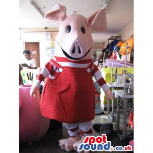 Pig mascot in red jumper with a cute smile in her face - Custom